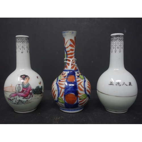 3 - A pair of Chinese miniature vases, decorated with a lady in a garden setting, seal mark to bases, H....