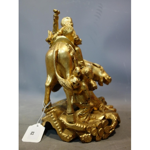 5 - A Chinese gilt painted wooden figural carving of a man on a horse and a traveller, H.31cm...