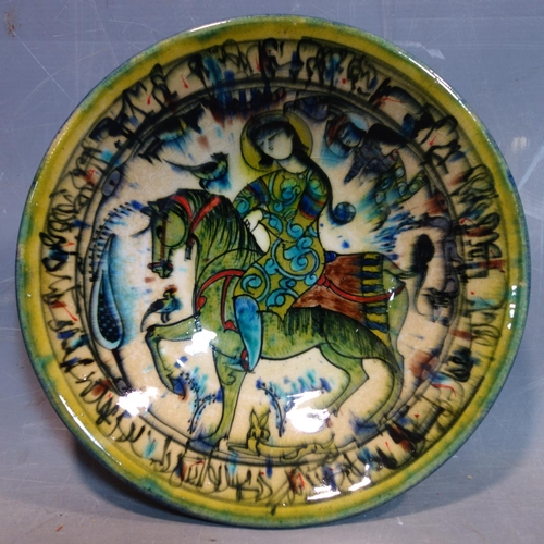 24 - A Persian glazed ceramic bowl, decorated with a lady on horseback, dated and marked to base, H.6.5cm...