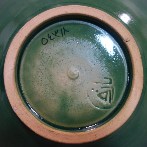 25 - Persian glazed ceramic bowl, made in Tehran, date and makers mark to reverse, depicting a Persian lo...