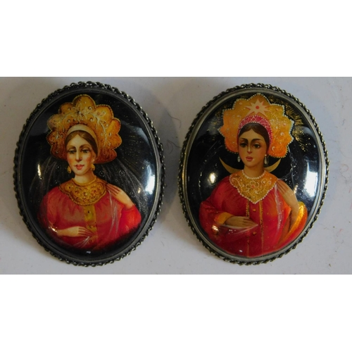 1 - A pair of hand painted Indian brooches. 5x4cm...