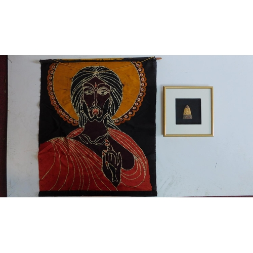 2 - A framed and glazed carving of a deity and a religeous scroll. 72x62cm....