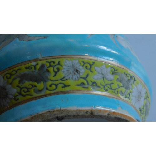 9 - A 19th century Chinese turquoise glazed Dayazhai  vase, decorated with dragons. (repairs) 35x17cm....