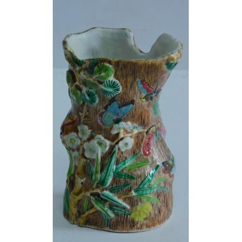 10 - A mid 19th century Chinese brush pot decorated with foo dogs, flowers and butterflies, 11x7cm....