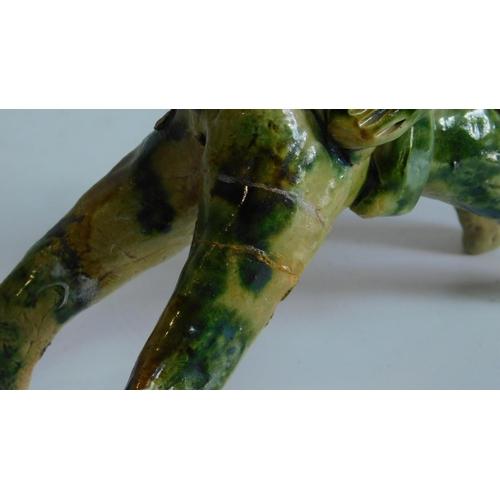 13 - A Sancai glazed horseman. 14x14cm...