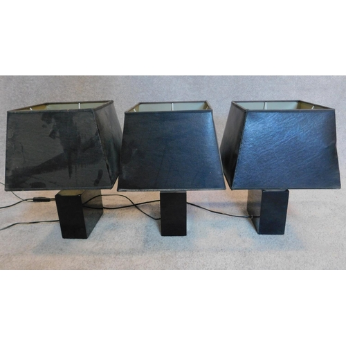 157 - Three matching table lamps with black shades and bases. 18x15cm...