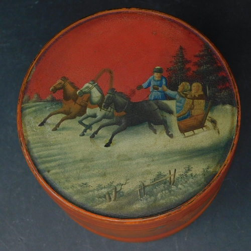 36 - A late 19th century Russian lacquered tobacco box, depicting horse sleigh scene, H.10 D.12cm...
