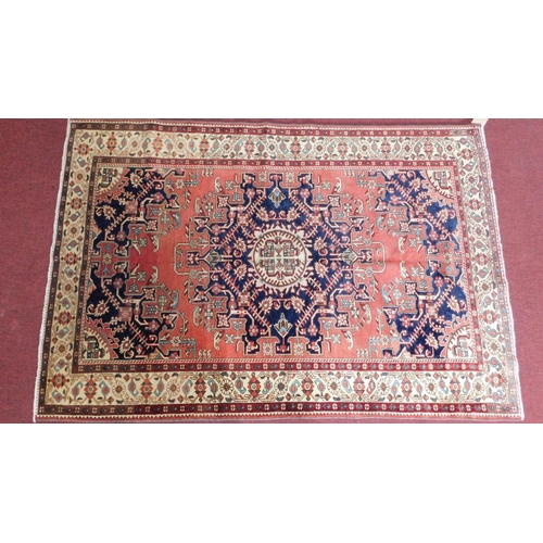 68 - A Tafresh rug, central pole medallion with repeating petal motifs on a rouge field guarded by a mult...