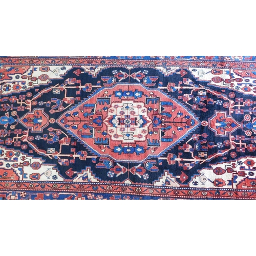 70 - A north west Persian Nahawand carpet with central double pendant medallion with repeating petal moti...
