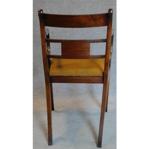 49 - A mahogany Regency style desk chair. H.83cm...