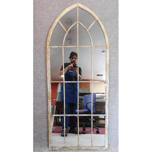 153 - A pair of arched Gothic style window pane garden mirrors. 158x66cm...