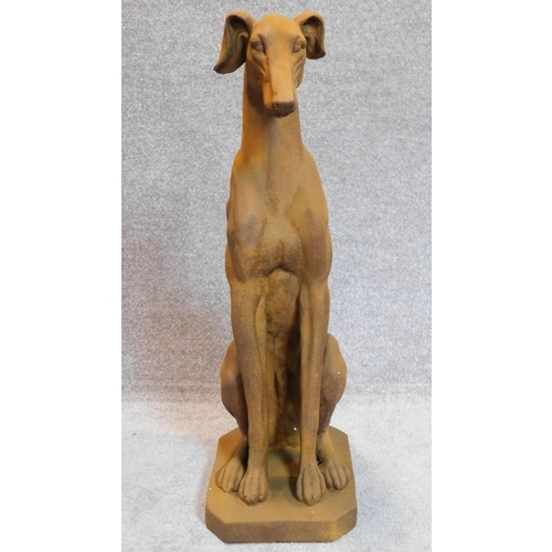 154 - A seated metal figure of a greyhound. H.83cm...