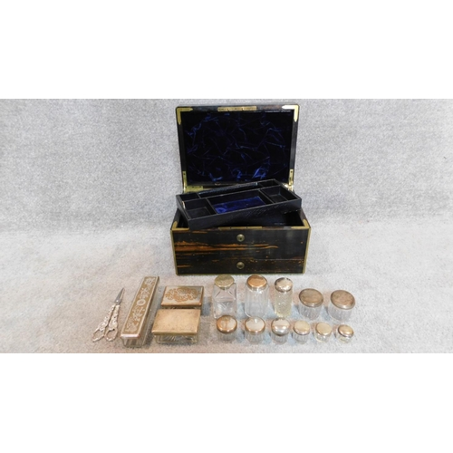289 - A mid 19th century Asprey coromandel and brass bound fitted dressing table box with inset brass labe...