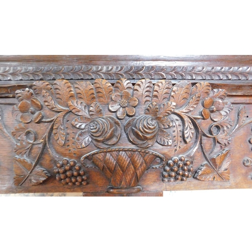 4 - WITHDRAWN - An antique French oak armoire with well carved floral and bouquet decoration fitted orna...