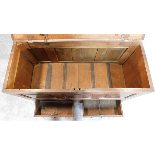5 - WITHDRAWN - A Georgian panelled oak coffer with hinged lid and fitted with two base drawers on block...