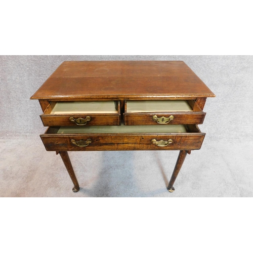 6 - A Georgian country oak lowboy, fitted drawers on cabriole supports. 70x72x45cm...
