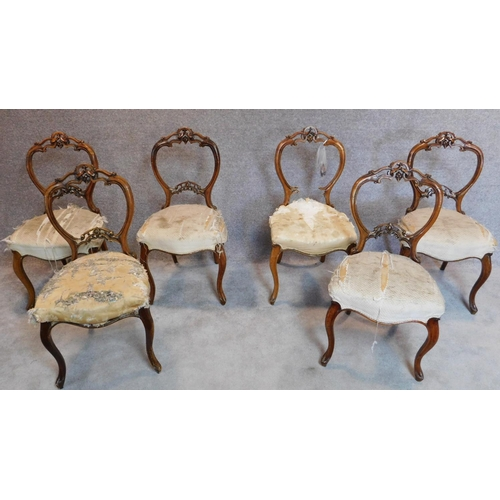 9 - A set of six Victorian carved walnut balloon back dining chairs. H.89cm (one splat broken but presen...