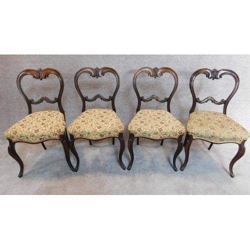 10 - A set of four Victorian rosewood balloon back dining chairs H.84cm...