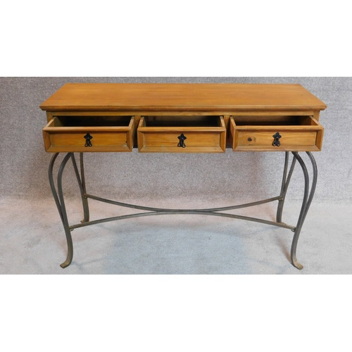 39 - 20th Century pitch pine console table with three drawers on cabriole wrought iron legs....