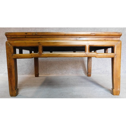 44 - A Chinese style teak low table with inset rattan top. 50x88x88cm...
