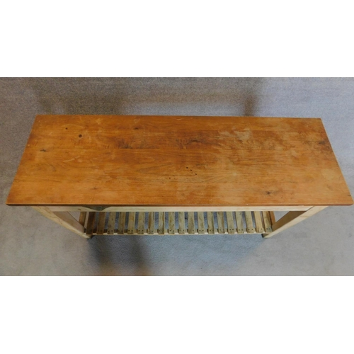 46 - A teak plank top kitchen table with fitted end drawers on distressed base on square tapering support...