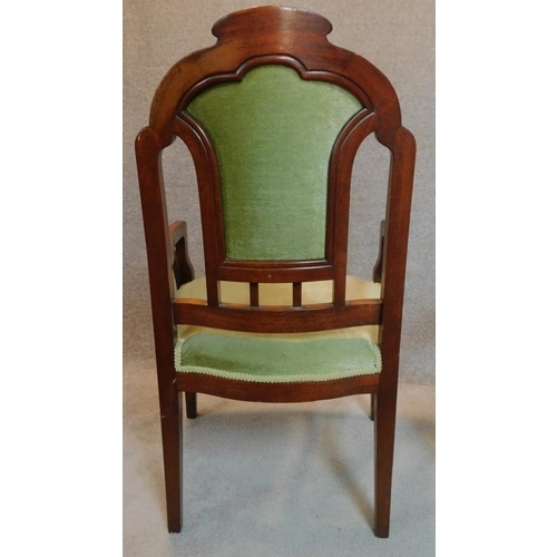 11 - A pair of walnut framed Art Nouveau carved back armchairs. H.106cm...
