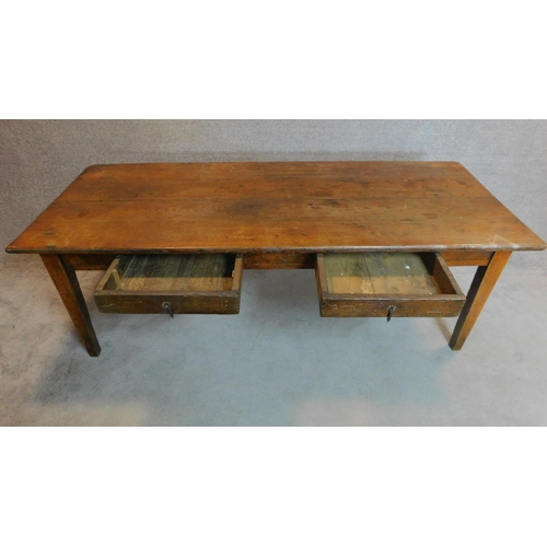 14 - An antique elm farmhouse style refectory table fitted two frieze drawers on square section tapering ...