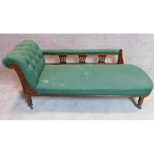 21 - A late Victorian walnut framed chaise longue in green upholstery on turned supports. 75x165x67cm...