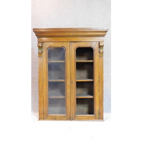 23 - A late Victorian mahogany bookcase section with twin glazed doors. 122x98cm (One pane detached but p...
