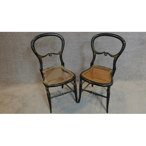 33 - A pair of late Victorian ebonised and mother of pearl inlaid balloon back bedroom chairs. H.83cm...