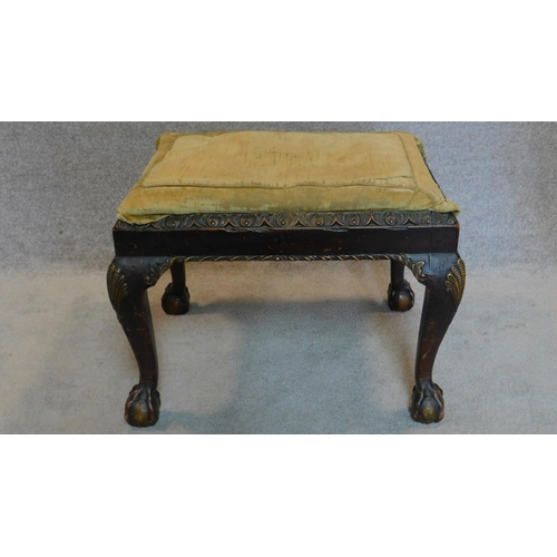 87 - A mid Georgian mahogany stool on cabriole supports with gilt decorated shell motif to each knee. 46x...