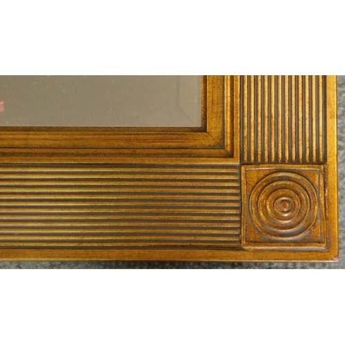 55 - A reeded gilt framed rectangular mirror with bevelled plate. 94x69cm