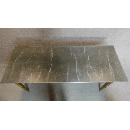 28 - A 19th century pitch pine refectory dining table with studded zinc top on square tapering supports. ...