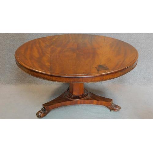 37 - A Victorian mahogany circular tilt top dining table on tripod pedestal base. H.73 W.133cm...
