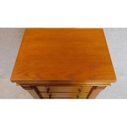 38 - A Victorian honey oak Wellington chest of six oak lined graduating drawers flanked by carved pilaste...