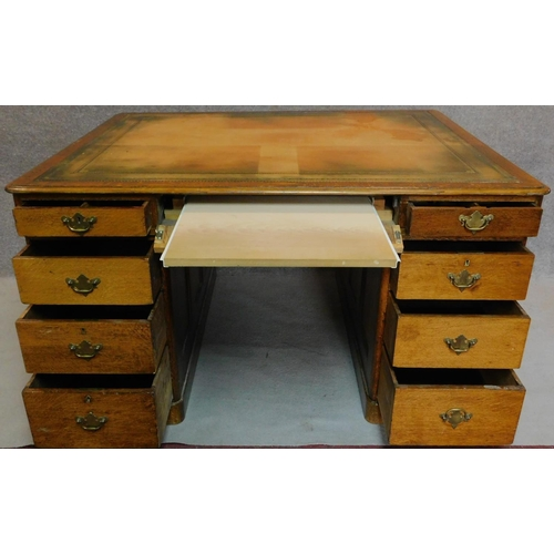 43 - A Victorian oak partners desk with original tooled leather top above frieze drawers and pedestal dra...