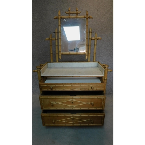 1 - A Victorian pitch pine dressing table in the faux bamboo style with inset marble top. H.173 W.112 D....