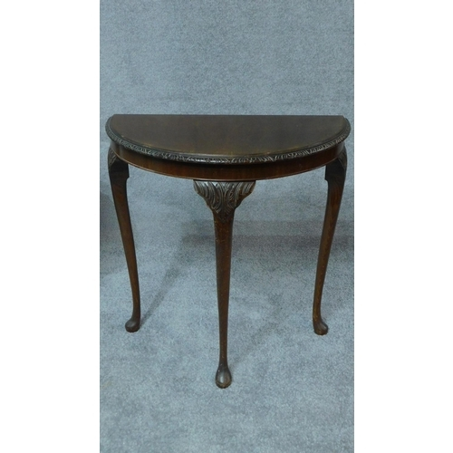 69 - An Edwardian walnut centre table and demi lune side table. H.74cm...