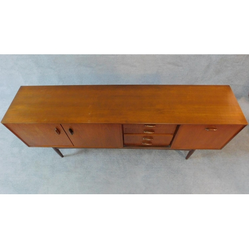 73 - A mid 20th century teak G-Plan sideboard fitted cupboards and drawers. H.79 W.206 D.48cm...