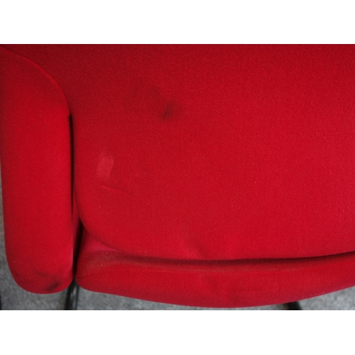 79 - A pair of red upholstered Herman Miller armchairs on tubular metal cantilever bases. H.83...