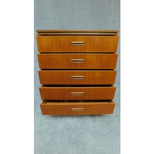 80 - A mid 20th century teak chest of five long drawers. H.107 W.76 D.42cm...