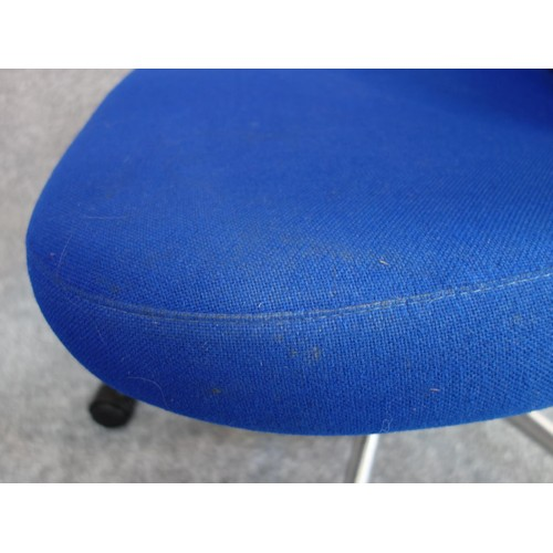 81 - A pair of blue upholstered swivel chairs, Vitra label to base. H.102...