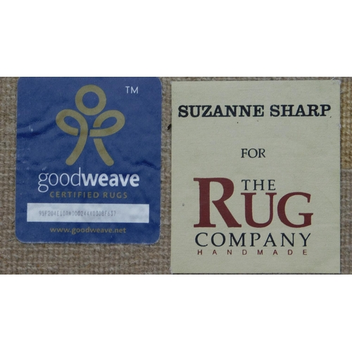 172 - A Suzanne Sharp hand made floral rug with repeating petal and spandrel motifs 242x306cm...