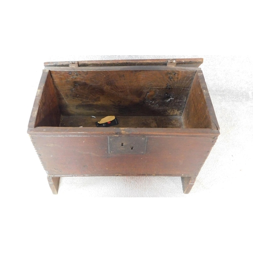 66 - A small antique oak plank coffer with original hinges, clasp and lock with dentil carved top and pan...