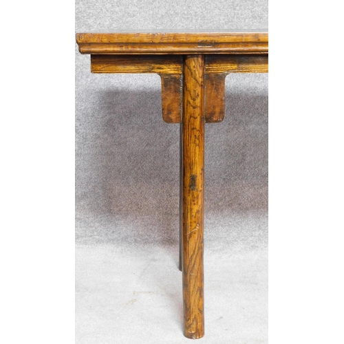 14 - A large Chinese hardwood alter table with rectangular top on circular section supports. H.81 W.223 D...