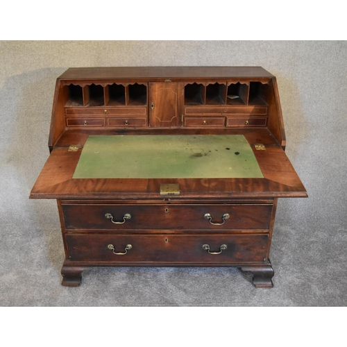 7 - A Georgian mahogany bureau with fall front revealing fitted interior above four long drawers on brac...