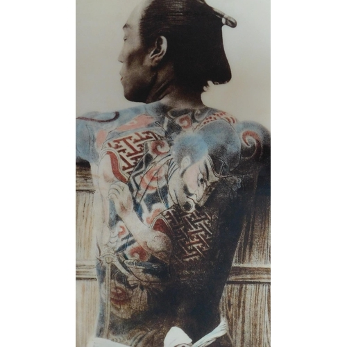 250 - A framed Kusakabe Kimbei Tattoo Photo. The photo has an acrylic gloss protective shield and is ?shad...