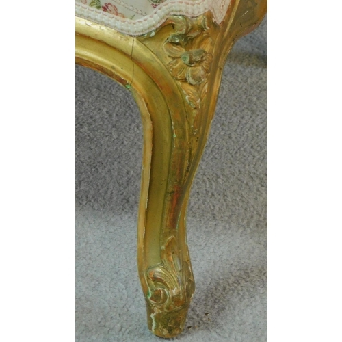 8 - A 19th century rococo style giltwood three seat canape with shell carved cresting back rail and flor...