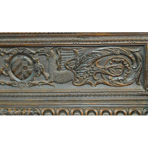 7 - An 18th century Italian carved oak hall bench fitted hinged seating compartment on block scroll carv...