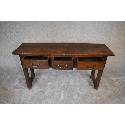 10 - An antique country oak sideboard fitted three frieze drawers on square supports. H.76 x 130 x 43cm...